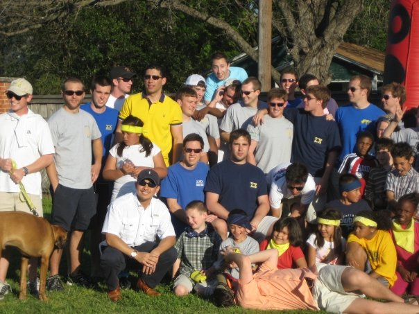 An old picture of some of the guys at their philanthropy event, Derby Days, with some local kids. Lance is the guy laying at the bottom playing with the kids instead of looking at the camera.